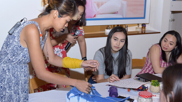 The attendees took a crash course on furoshiki wrapping.
