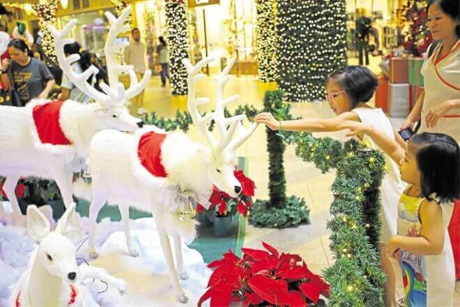 Red poinsettias, polar bear and reindeer—the children love a Rockwell Christmas.