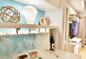 White and teal built-in storage cabinet